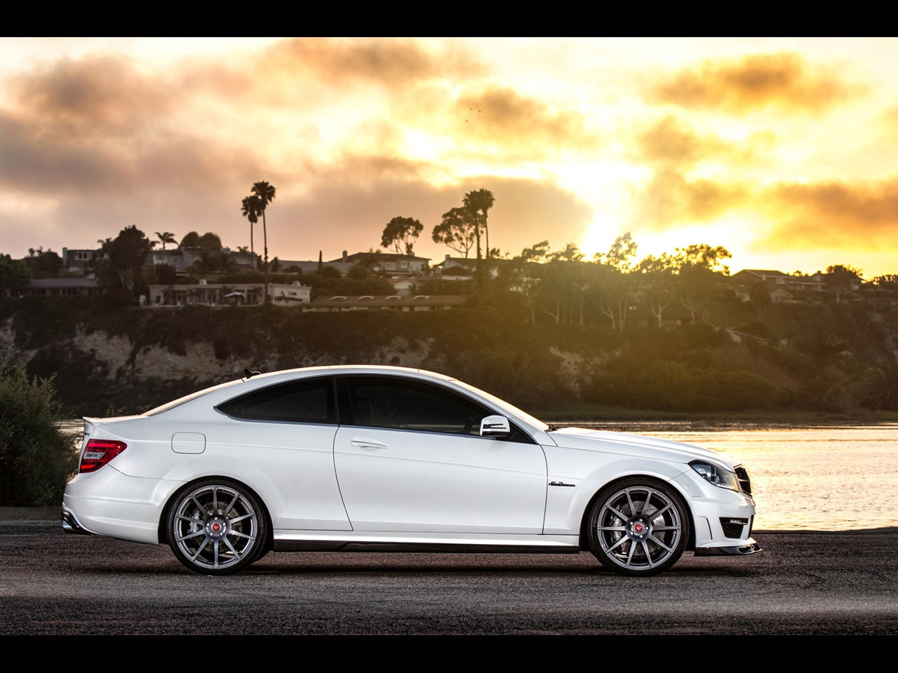 2013 mercedes benz c63 amg side static wallpapers and stock photos