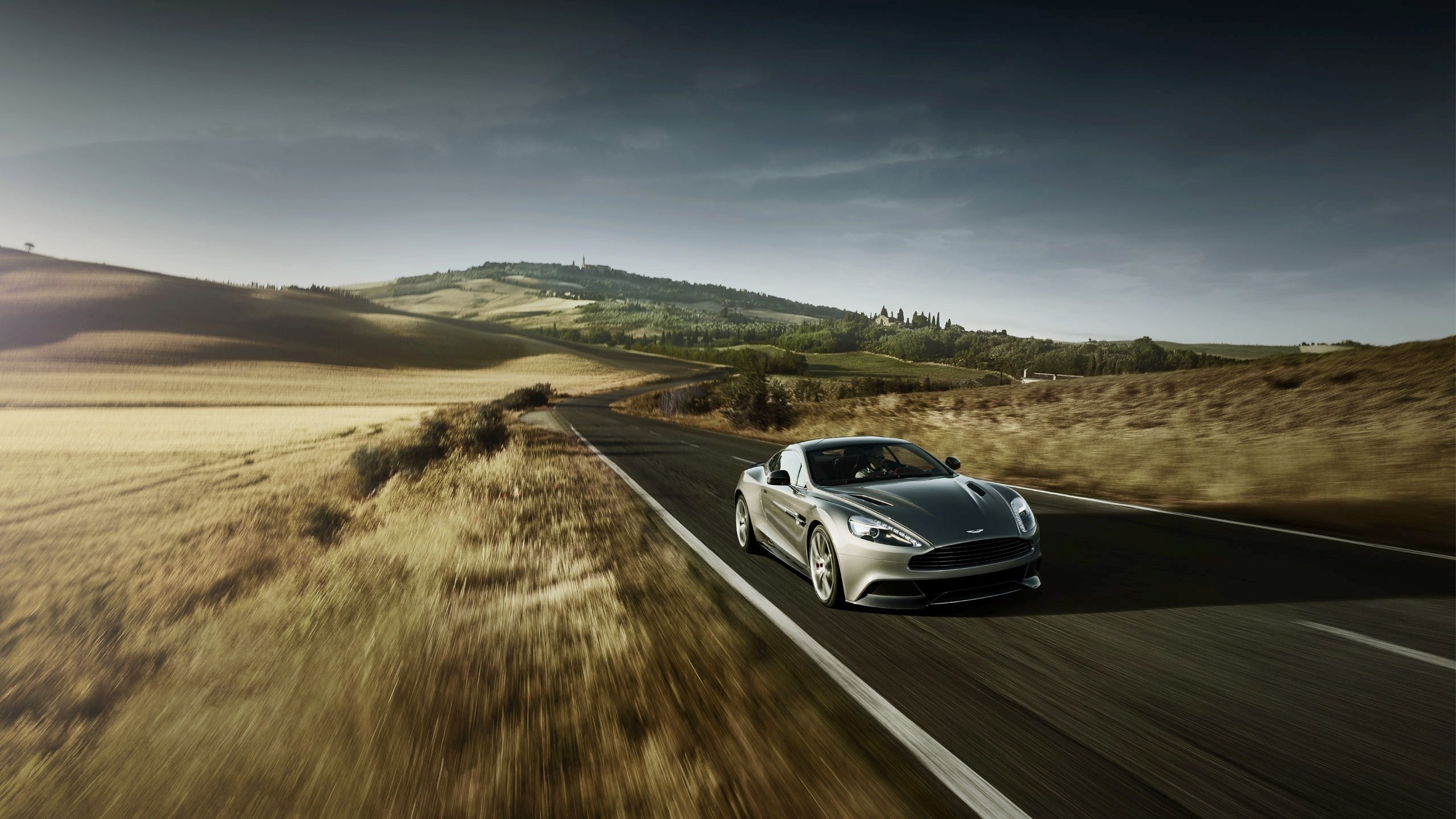 Aston Martin Stock >> 2560x1440 Aston Martin Speeding desktop PC and Mac wallpaper