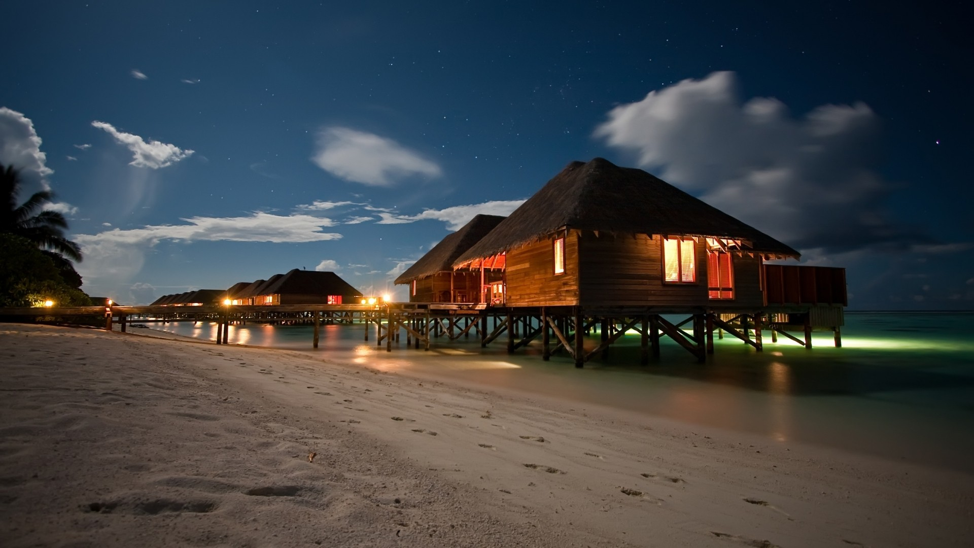 1920x1080 beach houses at night desktop pc and mac wallpaper