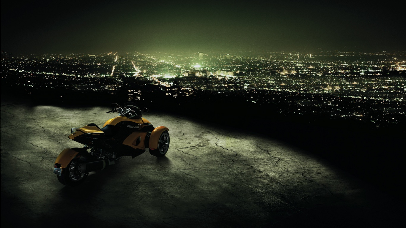 1366x768 Can Am Spyder Trike Looking Over The City Desktop