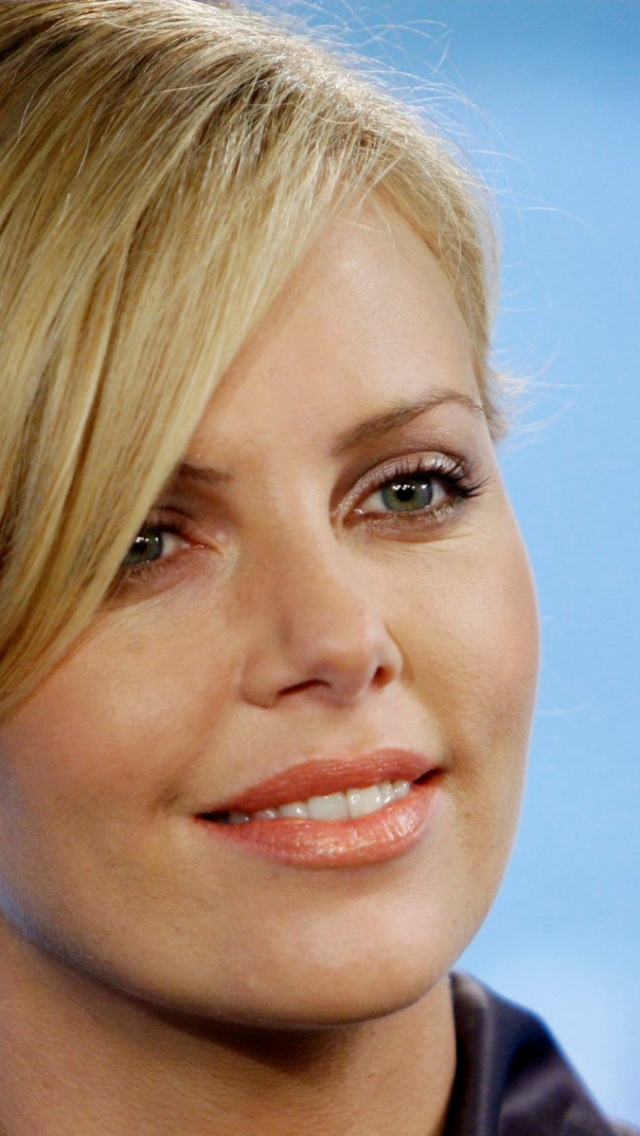 640x1136 Charlize Theron Smile Iphone 5 Wallpaper