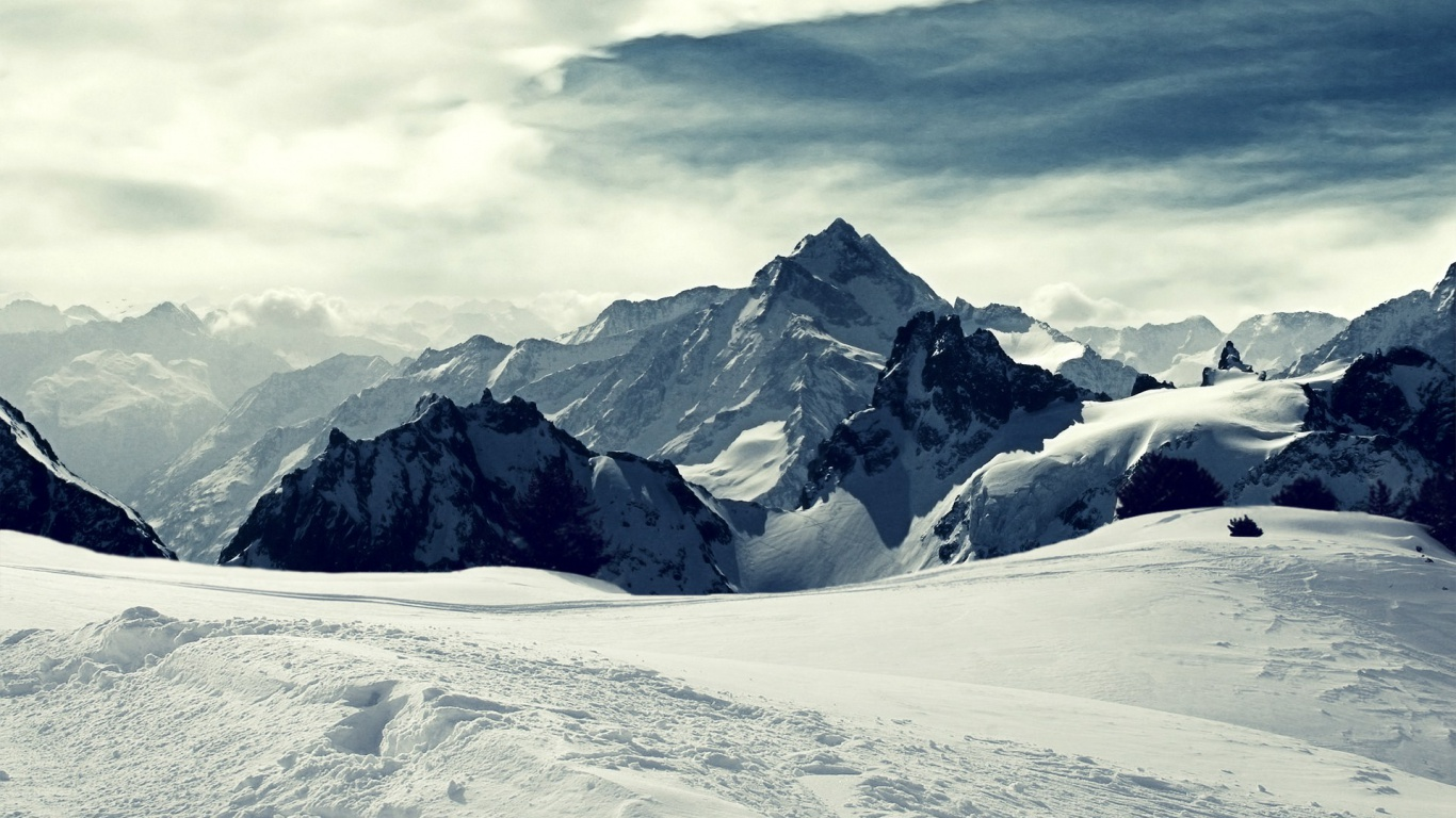 1366x768 Mountains Peak Snowy Clouds