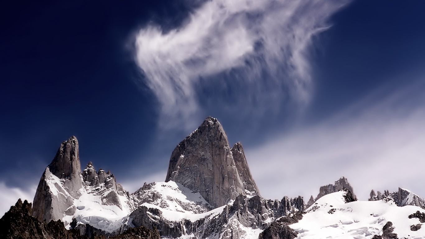 1366x768 tall rock and clouds desktop pc and mac wallpaper