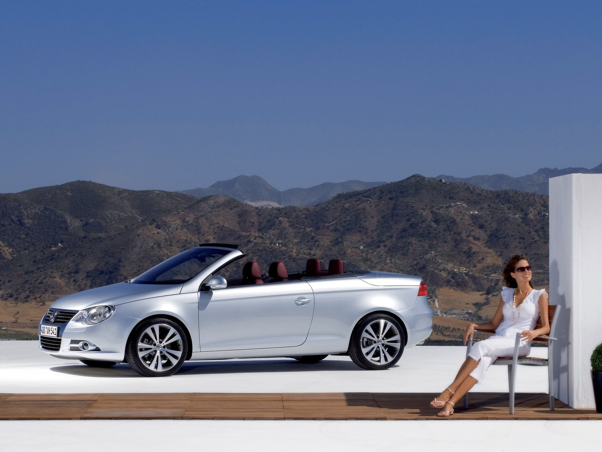 VW Eos with woman wallpapers | VW Eos with woman stock photos
