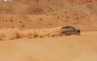 Audi Q7 in desert wallpapers and stock photos