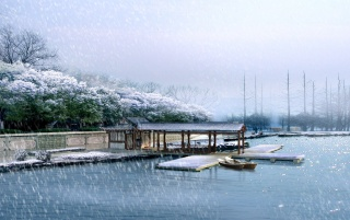 Snowing over lake wallpapers and stock photos