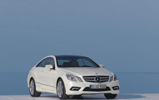 White E class coupe wallpapers and stock photos