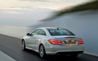 E coupe rear blur wallpapers and stock photos