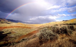 Rainbow over hills wallpapers and stock photos