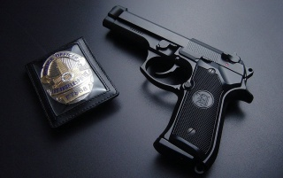 Badge and gun wallpapers and stock photos