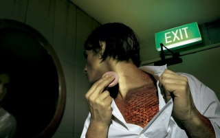 Man and exit sign wallpapers and stock photos