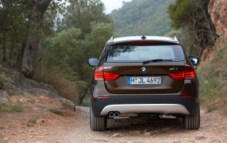 BMW X1 brown rear wallpapers and stock photos