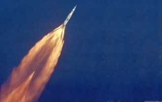 Apollo 11 - Rocket in the sky wallpapers and stock photos