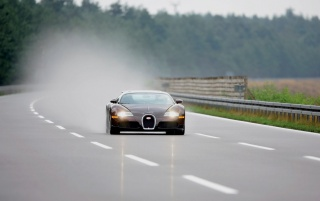 Bugatti Veyron in rain wallpapers and stock photos