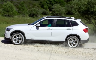 BMW X1 Side Speed White wallpapers and stock photos