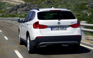 BMW X1 Rear Angle Speed White wallpapers and stock photos