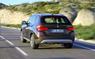 BMW X1 Rear Angle Speed Brown 2 wallpapers and stock photos