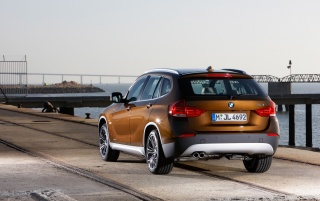 BMW X1 Rear Angle Brown wallpapers and stock photos