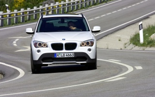 BMW X1 Front Speed White wallpapers and stock photos