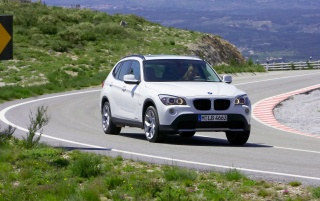 BMW X1 Front Speed White 2 wallpapers and stock photos