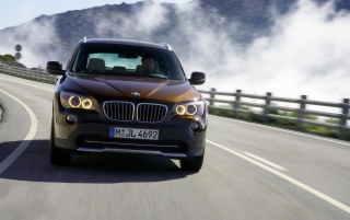 BMW X1 Front Speed Brown wallpapers and stock photos