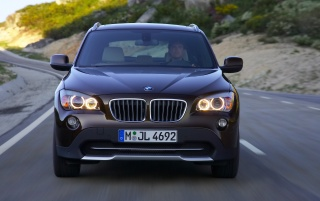 BMW X1 Front Speed Brown 2 wallpapers and stock photos