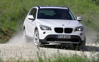 BMW X1 Front Angle White wallpapers and stock photos