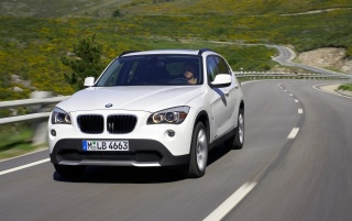 BMW X1 Front Speed White 3 wallpapers and stock photos