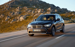BMW X1 Front Speed Brown 3 wallpapers and stock photos