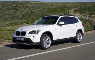 BMW X1 Front and Side Speed White wallpapers and stock photos