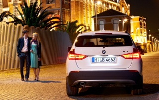 BMW X1 Couple 2 wallpapers and stock photos