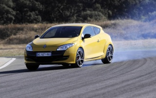 2010 Megane Sport Front Angle Smoke wallpapers and stock photos