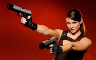 Alison Carroll with guns wallpapers and stock photos