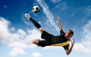 Kick the ball in the air wallpapers and stock photos