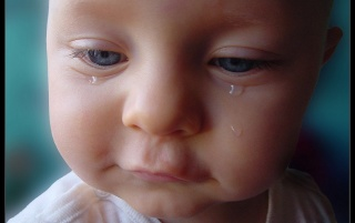 Baby crying wallpapers and stock photos