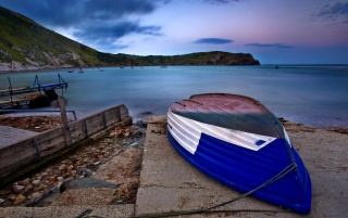 Blue boat on beach wallpapers and stock photos