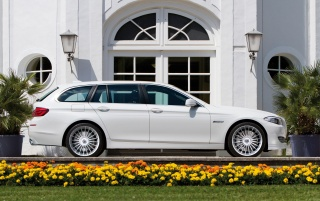 White Alpina B5 side wallpapers and stock photos