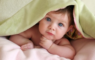 Cute baby in bed wallpapers and stock photos