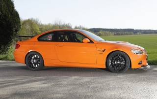 Orange M3 side view wallpapers and stock photos