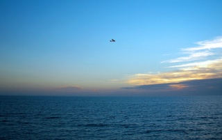 Plane over sea wallpapers and stock photos