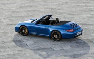 Blue Porsche Carrera 4 GTS Cabrio wallpapers and stock photos