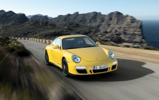 Yellow Carrera 4 GTS on the road wallpapers and stock photos