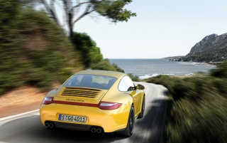 Yellow Porsche Carrera 4 GTS Rear wallpapers and stock photos