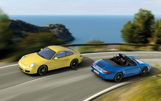 Porsche Duo racing by the sea wallpapers and stock photos