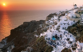 Sunset on the island of Santorini - Greece wallpapers and stock photos