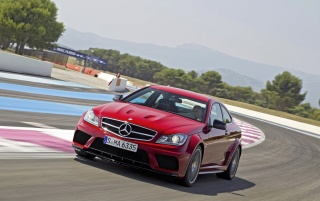 Mercedes C 63 AMG Coupe Black Series Front Angle Speed wallpapers and stock photos