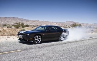 Dodge Challenger SRT8 392 Front And Side Smoke wallpapers and stock photos