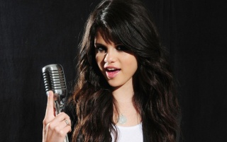 Selena Gomez Sings wallpapers and stock photos