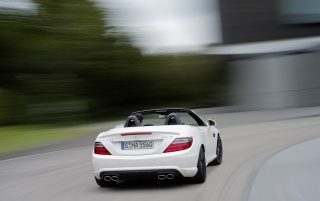 Mercedes Benz SLK 55 AMG Rear Angle Speed wallpapers and stock photos