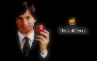 Steve Jobs with Apple wallpapers and stock photos
